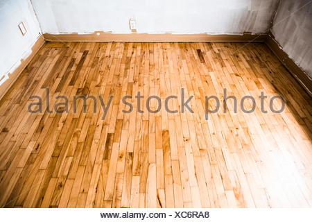 Empty Wood Floor And Painted Walls Home Renovations Stock Photo