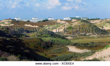 grass-grown dunes Coepelduynen at the North Sea Coast, European Space Research and Technology Centre in background, Netherlands, South Holland, Noordwijk aan Zee - Stock Photo