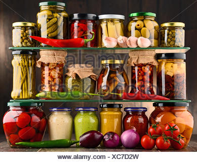 Jars with variety of pickled vegetables. - Stock Photo