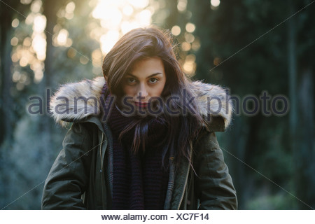 Portrait of attractive young woman in forest - Stock Photo
