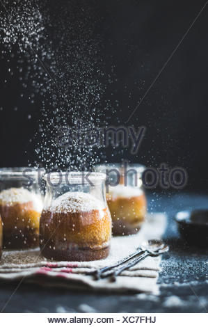 Puddings chomeurs with maple and chestnut flour - Stock Photo