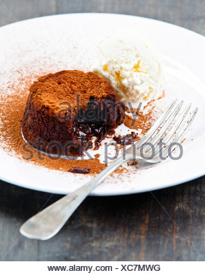 Chocolate fondant with vanilla ice cream - Stock Photo