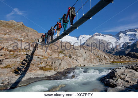 Traveller, Gauligletschersee, Urbachtal, mountain, mountains, canton, Bern, Gauli, Gauligebiet, Gauligletscher, bridge, suspensi - Stock Photo