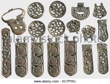 A set of Avar relics, Southeast Europe, 5th/6th century A.C. Bronze with greenish-brown patina. 22 different pieces, displaying elaborate openwork. Belt tips, buckles, bridle pieces, and mountings, including two pieces depicting horses. The large belt tip is slightly restored. Cleaned excavation discovery. Dimensions 2 to 12 cm. historic, historical, ancient world, Migration Period, Middle Ages, object, objects, stills, clipping, clippings, cut out, cut-out, cut-outs, metal fittings, iron mounting, iron mountings, accessory, accessories, jewellery, jewelry, Additional-Rights-Clearences-NA - Stock Photo