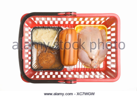 Shopping basket with convenience food, conserved sausages and a chicken in transparent plastic wrapping, studio shot - Stock Photo