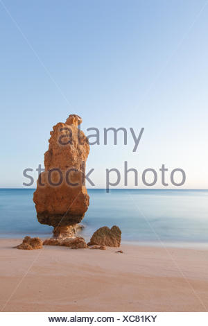 Portugal, Algarve, Praia da Marinha, Stack rock at sandy beach - Stock Photo