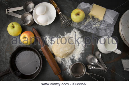 fresh dough with Ingredients for baking apple pie. Milk, eggs, butter, flour - Stock Photo