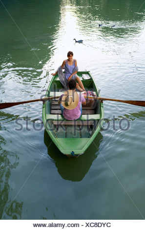 Man and woman in a boat - Stock Photo