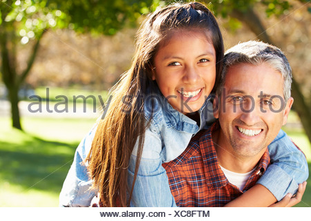 Portrait Of Father And Daughter In Countryside - Stock Photo