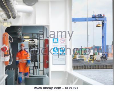 Sailor walking through gangway - Stock Photo