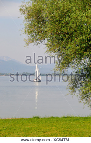 Sailboat in front of Fraueninsel, Women's Island, Lake Chiemsee, Chiemgau, Bavaria, Germany, Europe - Stock Photo