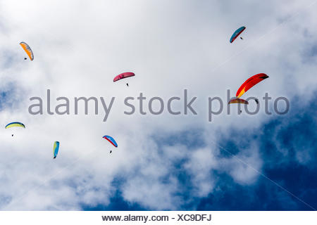Many paragliders are flying in the air, over Pokhara and Phewa Lake, Sarangkot, Kaski District, Nepal - Stock Photo