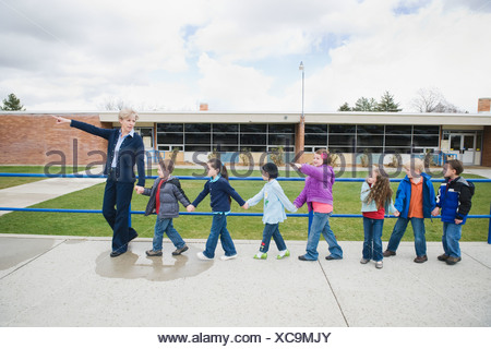 Elementary school students on a field trip - Stock Photo