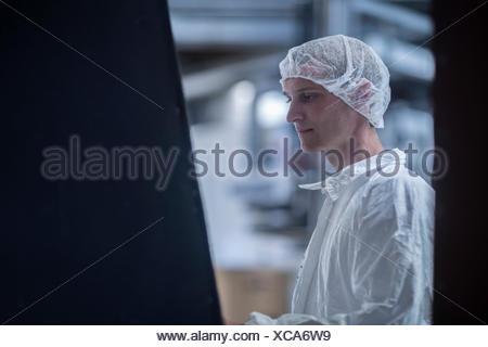 Clean room worker in an industry, Freiburg im Breisgau, Baden-Württemberg, Germany - Stock Photo