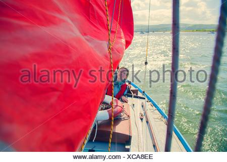 Mid adult woman on sailing boat - Stock Photo