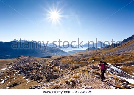 Hikers heading to the Bepi Zac via ferrata in the San Pallegrino valley, above San Pellegrino Pass or Passo San Pellegrino - Stock Photo