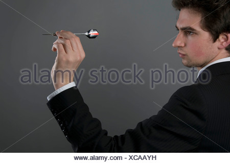 Male holding dart - Stock Photo