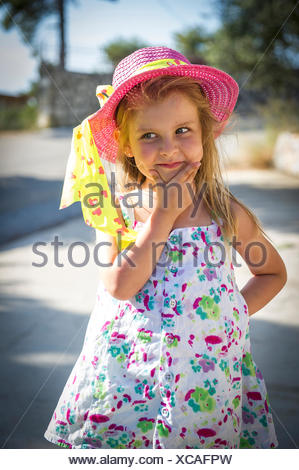 Front view of girl wearing summer hat