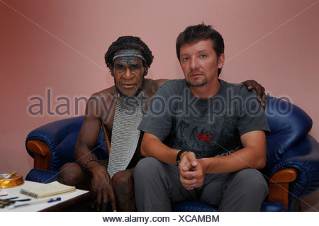 Dani, Big Man of a tribe in negotiations with a European man, Irian Jaya or West Papua, New Guinea, Indonesia, Southeast Asia - Stock Photo