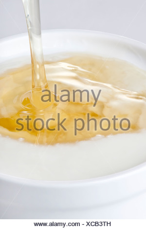 Close-Up of Honey Poured Into Yogurt - Stock Photo
