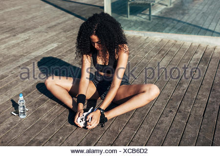 Young woman doing stretching exercises - Stock Photo