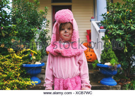 Young girl in pink poodle costume - Stock Photo