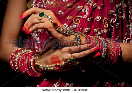 Close-up of jewelery on hands of Indian bride - Stock Photo
