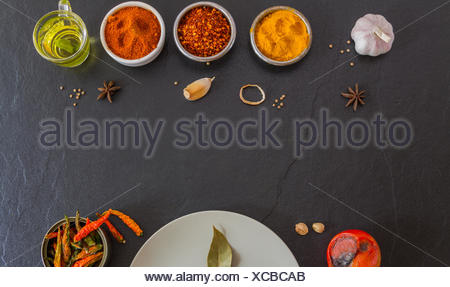 Mixed spices and herbs on background. - Stock Photo