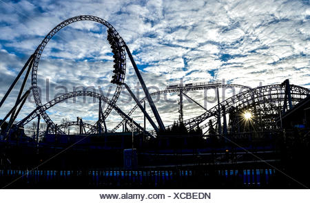 Silhouette of roller coaster in backlight, Europa-Park Rust, Germany - Stock Photo