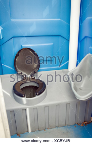 A commode in a camping toilet. - Stock Photo