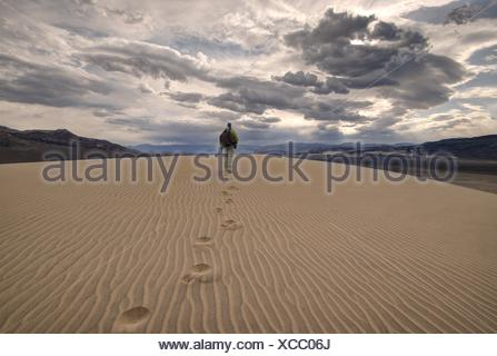 Man walking in the eureka dunes, death valley national park, California, America, USA - Stock Photo