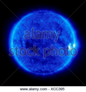 A bright area activity rotates into view limb Sun after period calm on Sun. image was created Solar Heliospheric Observatory - Stock Photo