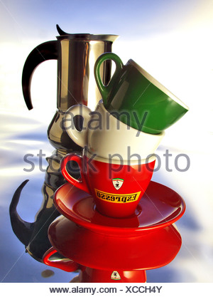 Red, white and green cups with espresso jug - Stock Photo