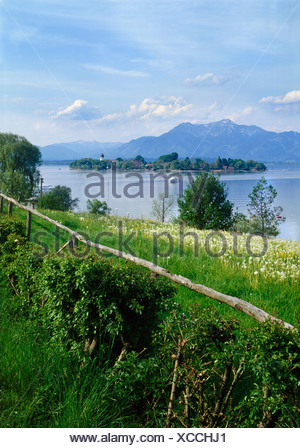 The Island Fraueninsel, Chiemsee lake in front of the Hochgern Mountain, Chiemgau, Upper Bavaria, Bavaria, Germany, Europe - Stock Photo