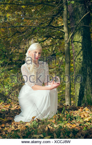 Fortune teller woman sitting in the woods - Stock Photo