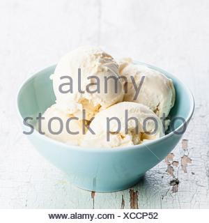Vanilla ice cream in blue bowl - Stock Photo