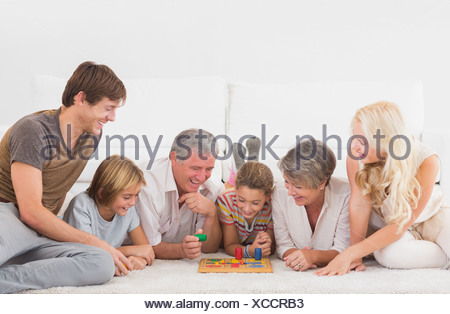 Family playing board games - Stock Photo