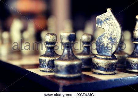 Close-Up Of Chess Pieces On Chess Board - Stock Photo