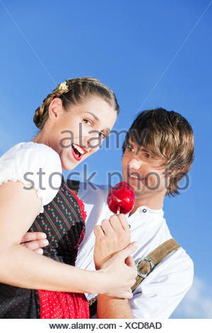 couple in tracht on festival or oktoberfest - Stock Photo
