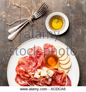 Platter of Assorted Snack ham, salami, cheese and honey - Stock Photo
