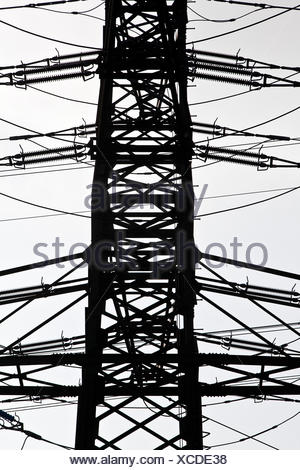 Power Pole With High Voltage Against The Blue Sky Stock Photo