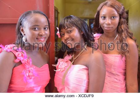 Three ladies in pink dresses at a wedding, 'Pink Wedding', Freetown, Sierra Leone - Stock Photo