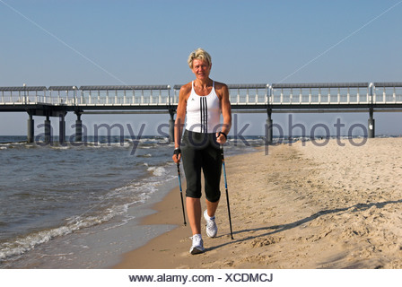 Personal trainer Sabine John at the beach of Heringsdorf, Usedom island, Mecklenburg Western Pomerania, Germany, Europe - Stock Photo