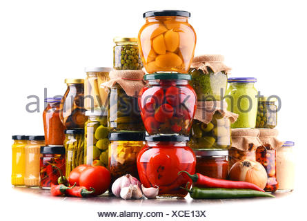 Jars with variety of pickled vegetables  isolated on white - Stock Photo