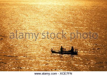 couple in a rowing-boat on Lake Sorpe at sunset, Germany, North Rhine-Westphalia, Sauerland, Sundern - Stock Photo