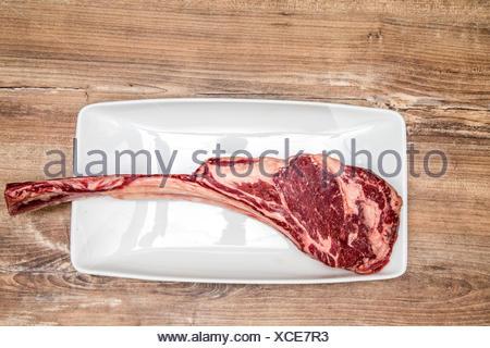 dry aged tomahawk - Stock Photo