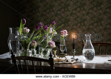 Sweden Wooden Table With Candle Burning Vases And Flowers In Vase