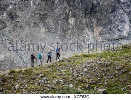 Switzerland, Arolla, Mountaineers at Mont Collon - Stock Photo