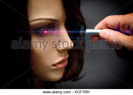 Laser pointer, mannequin, eye, dazzle, blind - Stock Photo