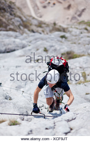 Climber on the Che Guevara fixed rope route on Mt. Monte Casale in the Sarca Valley, Lake Garda region, Trentino, Italy, Europe - Stock Photo